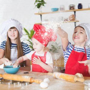 happy little children chefs preparing cookies in the kitchen.